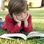 boy_reading_outside