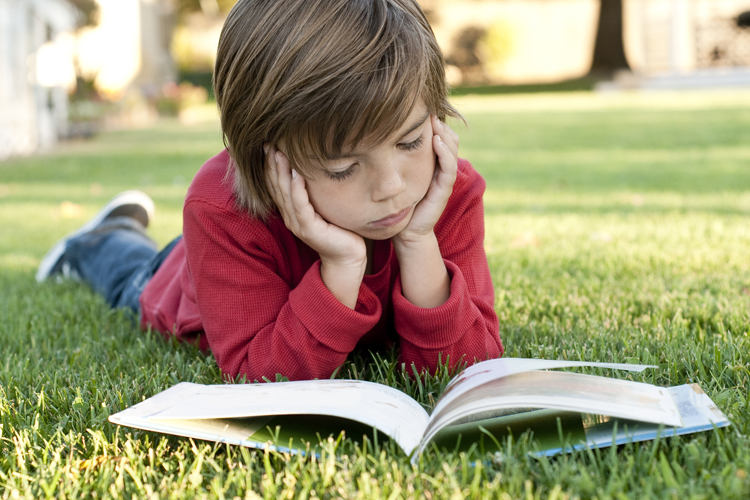 boy_reading_outside